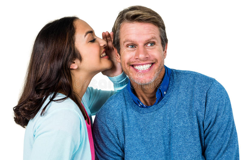 Woman sharing secret with man stock photos