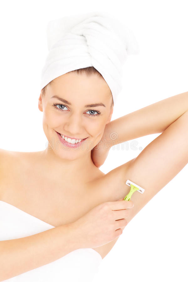 Woman shaving armpit royalty free stock photography