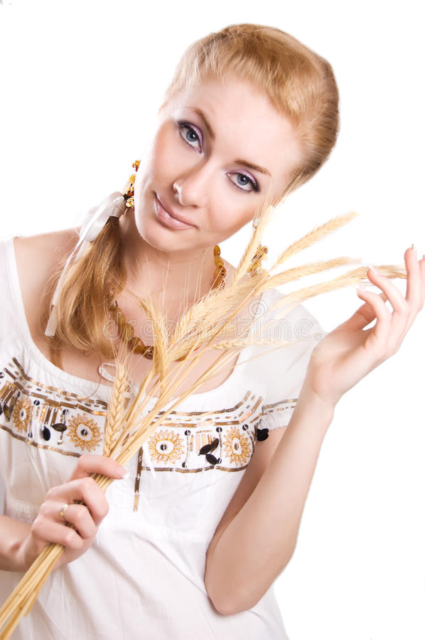 Woman with sheaf of wheat. Redheaded woman with sheaf of wheat isolated on white royalty free stock photos