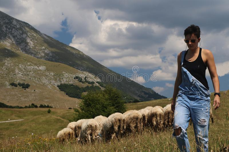 Download Woman With Sheeps In The Background Stock Photo - Image of beauty, ancient: 103432166
