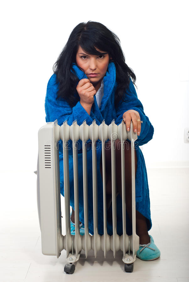 Woman shivering in house stock image
