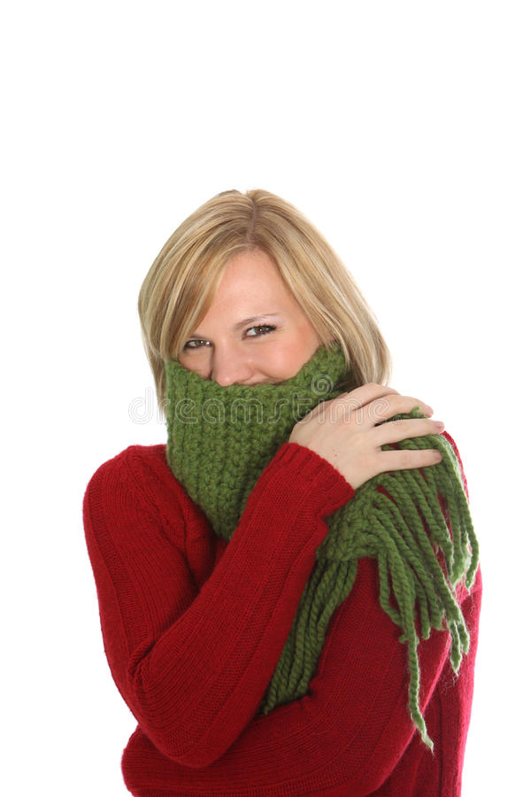 Woman shivering in the winter cold