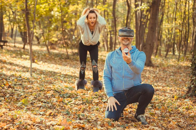 Woman is shocked because her boyfriend proposing virtual girlfriend. Woman is shocked because her boyfriend proposing virtual girl royalty free stock photography