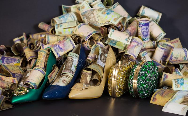Woman shoe and Bag in cash and paper currencies stock photo