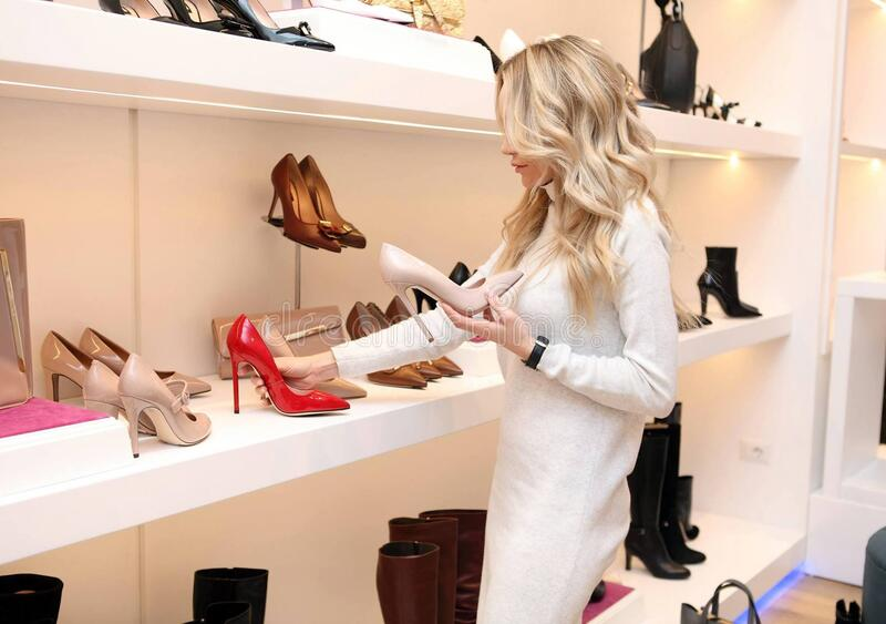 Woman At Shoe Store royalty free stock photography