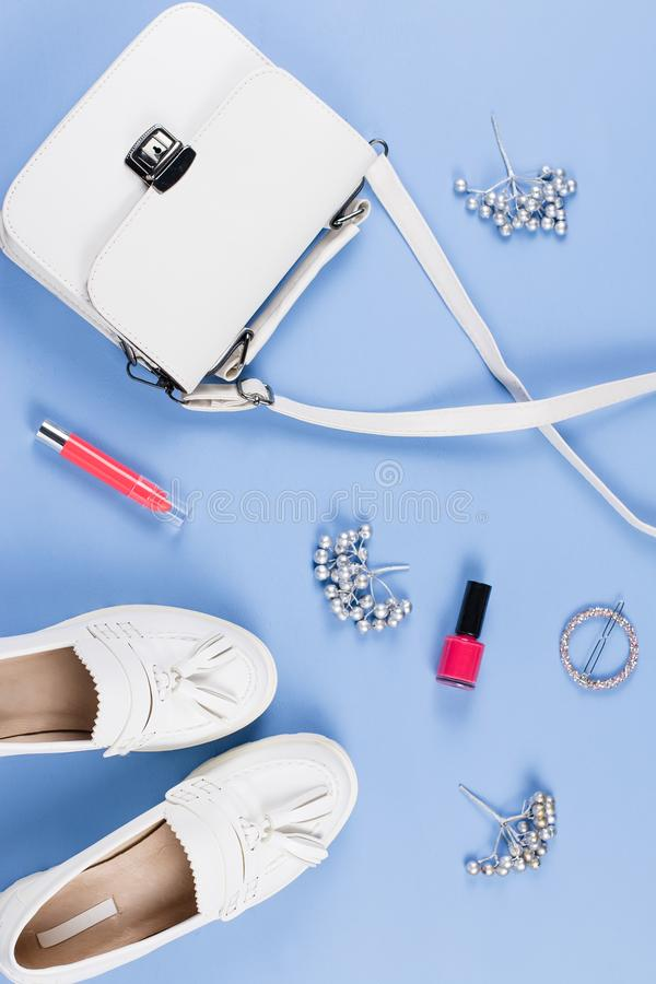 Woman shoes, purse and cosmetics flat lay. Female autumn fashion concept. Woman shoes, purse and cosmetics flat lay. Female autumn fashion stock image