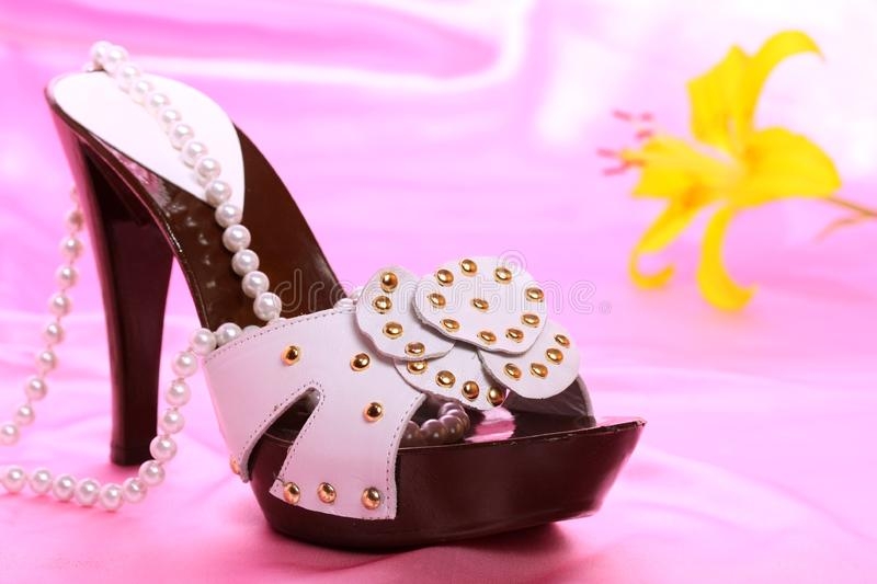 Woman shoes on satin