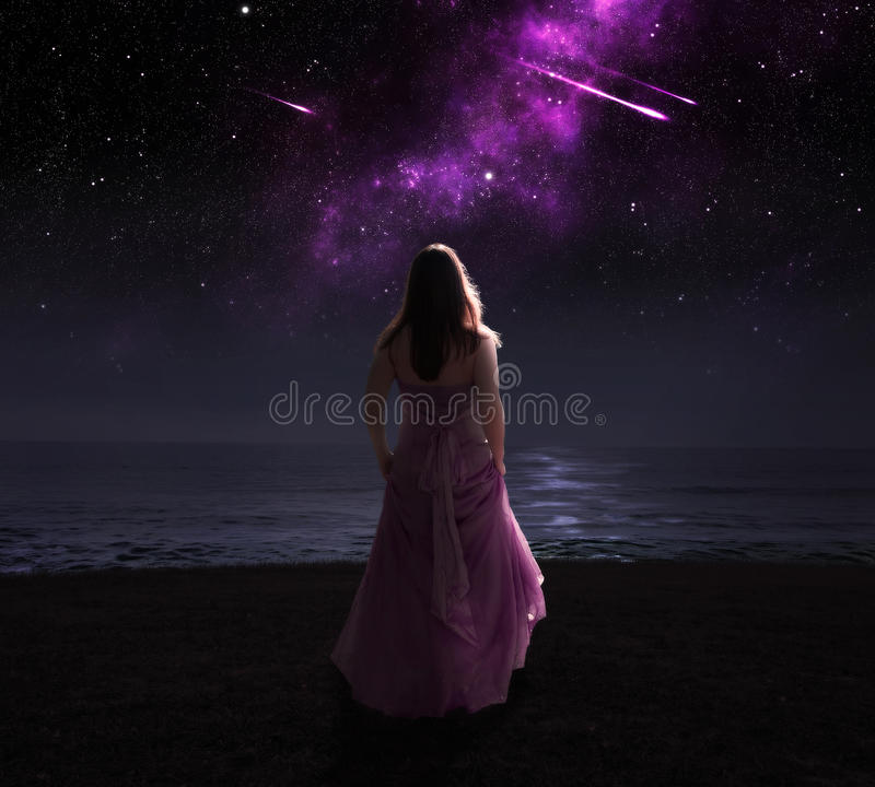 Woman and shooting stars. royalty free stock photography