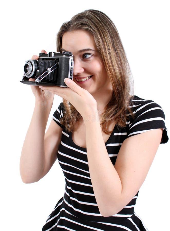 Woman shooting a vintage camera