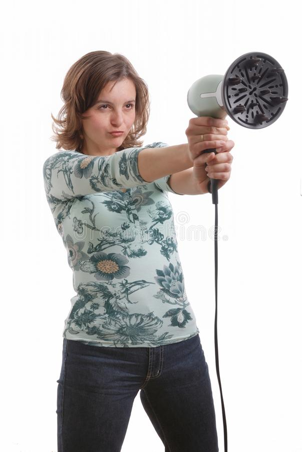 Woman Shoots With Hairdryer Royalty Free Stock Image