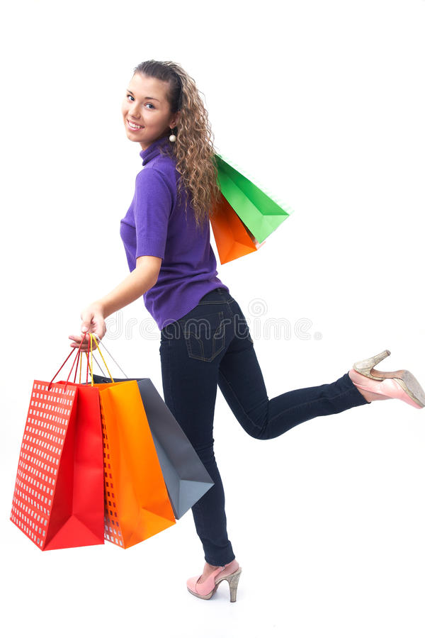 Woman on shopping. Cheerful young woman with shopping bags hurries to the shopping stock photos