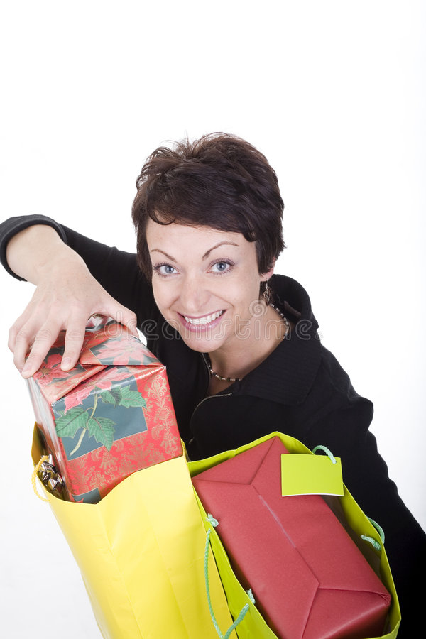 Woman shopping. Woman with shopping bags over white background royalty free stock photo