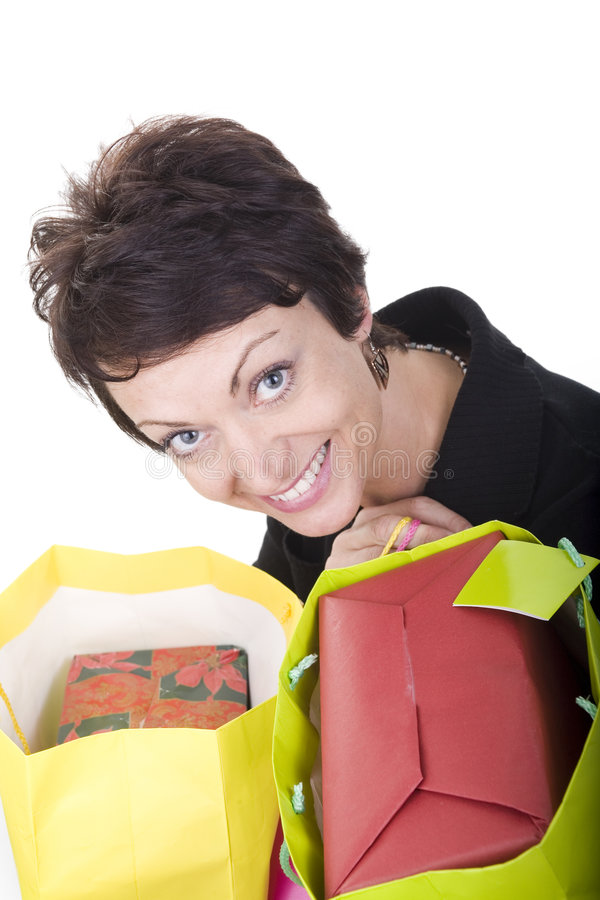 Woman shopping. Woman with shopping bags over white background royalty free stock images