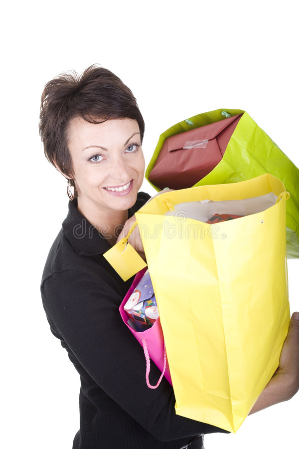 Woman shopping. Woman with shopping bags over white background royalty free stock image