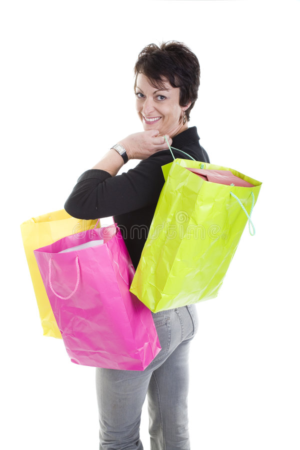 Woman shopping. Woman with shopping bags over white background royalty free stock photography