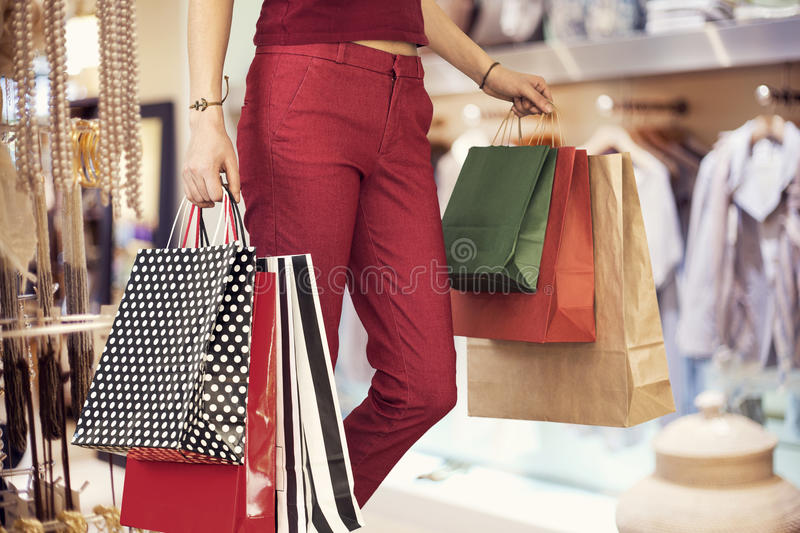 Woman shopping with bag in boutique royalty free stock image