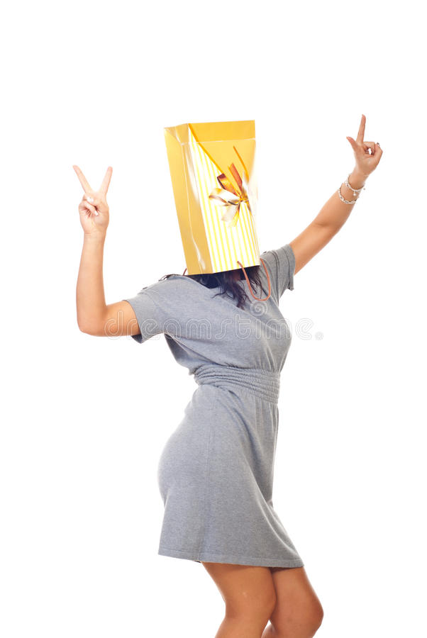 Woman with shopping bag on head royalty free stock photography