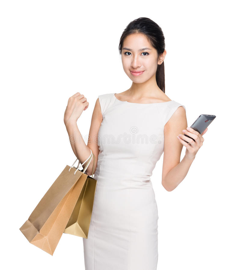 Woman with shopping bag and mobile phone. Isolated on white background stock photos
