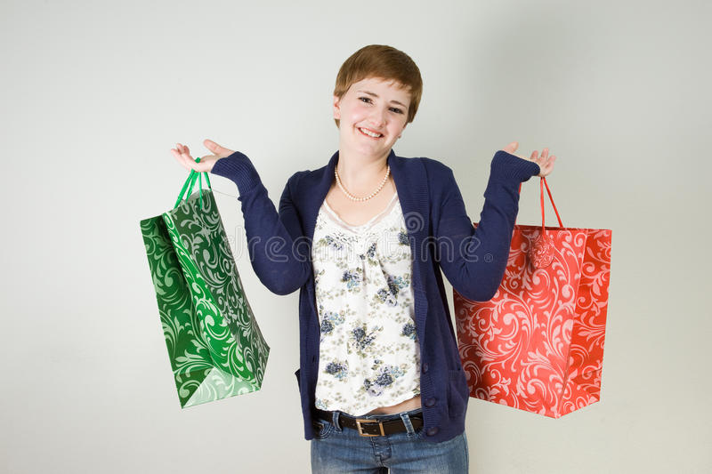 Download Woman With Shopping Bags Royalty Free Stock Photography - Image: 23077527