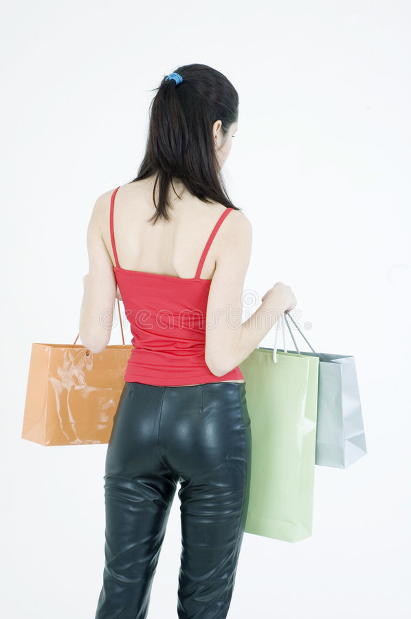 Download Woman with shopping bags stock image. Image of bags, back - 689963