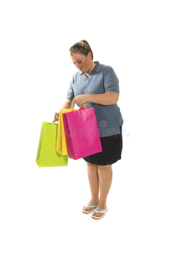 Woman with shopping bags. Over white royalty free stock photos