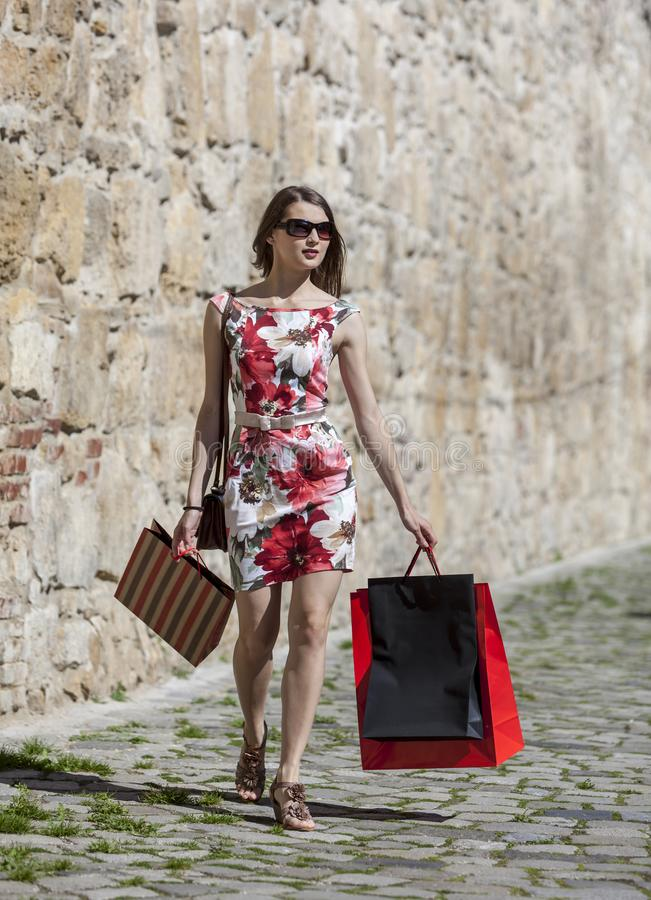 Woman with Shopping Bags in a City stock photo