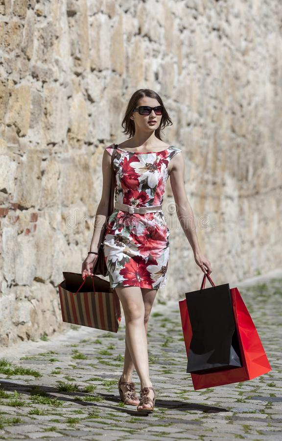 Woman with Shopping Bags in a City stock photos