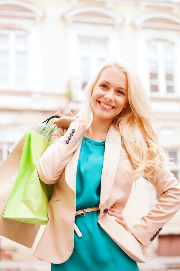Download Woman With Shopping Bags In Ctiy Stock Image - Image of outdoors, attractive: 33186349