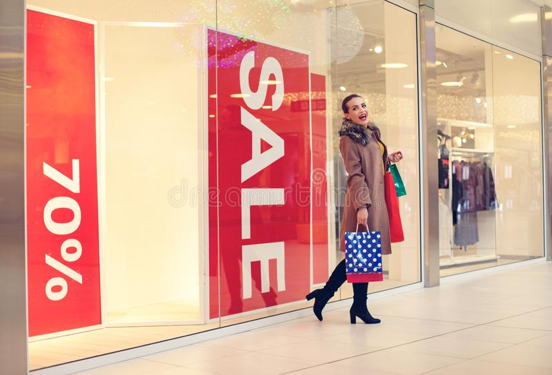 Woman in shopping. woman with shopping bags enjoying in shopping royalty free stock photography