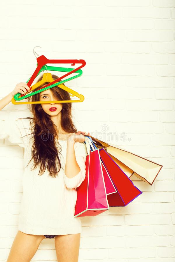 Woman with shopping bags and hangers stock photo