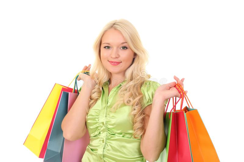 woman with shopping bags over white background stock image