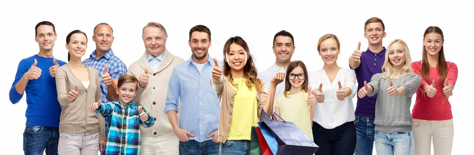 Woman with shopping bags and people show thumbs up stock images