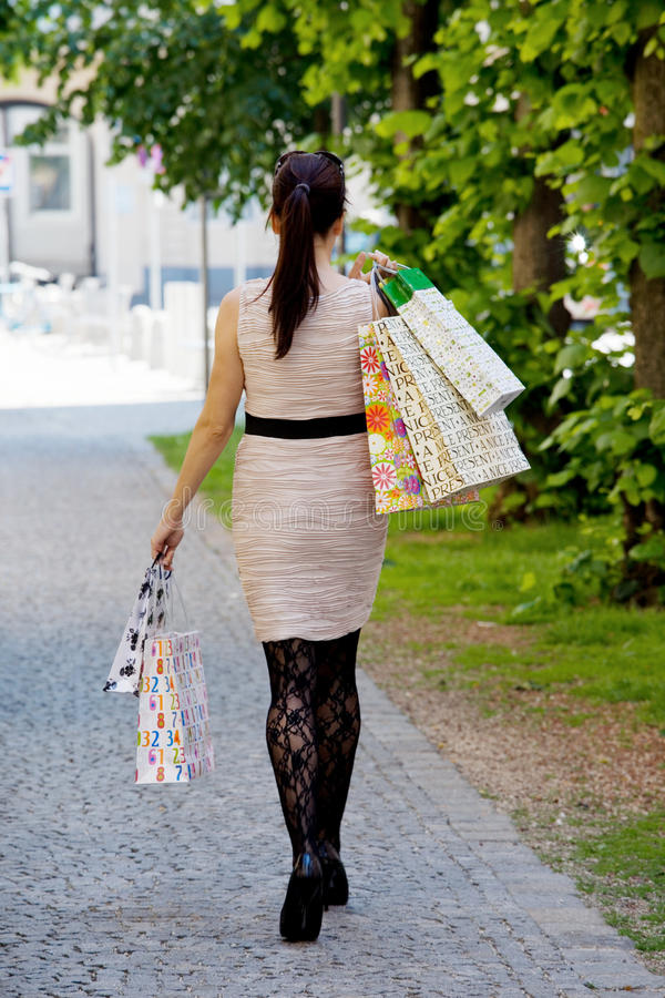 Woman with shopping bags while shopping royalty free stock images