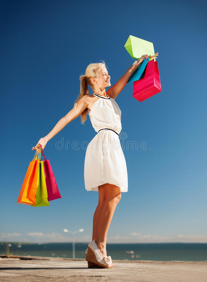 Woman with shopping bags. Shopping and tourism concept - woman with shopping bags stock images