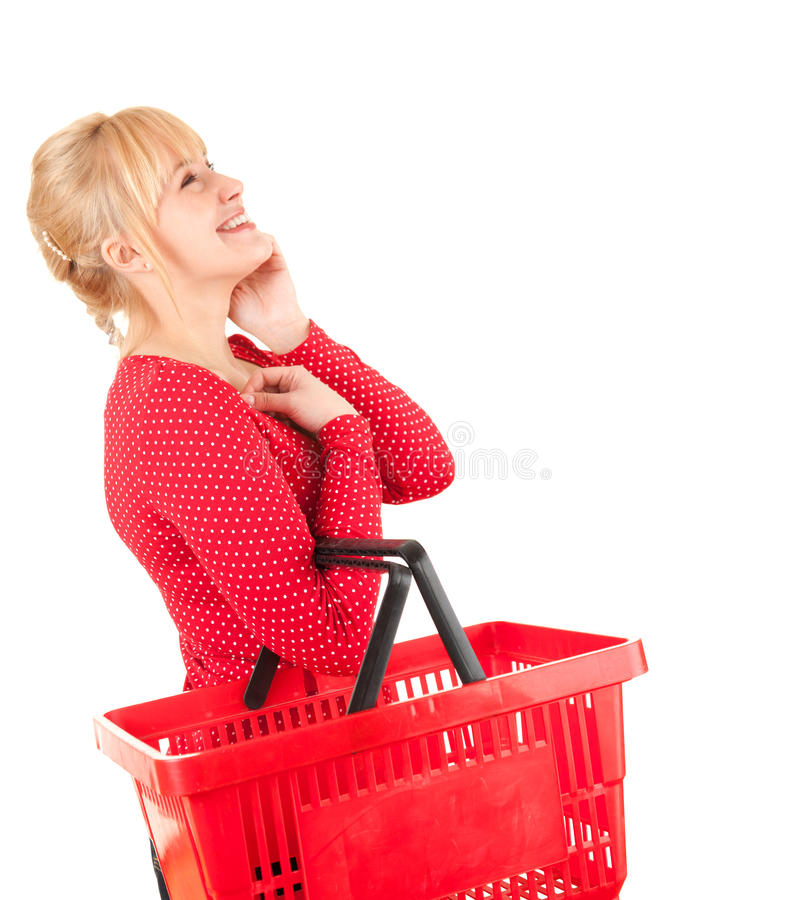 Woman with shopping basket looking up