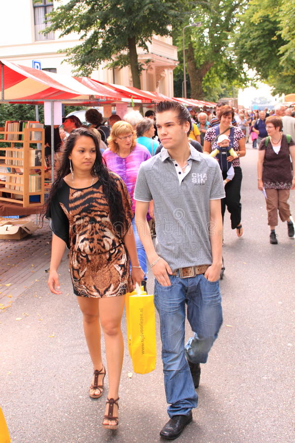 Woman shopping for books couple in the street stock photo