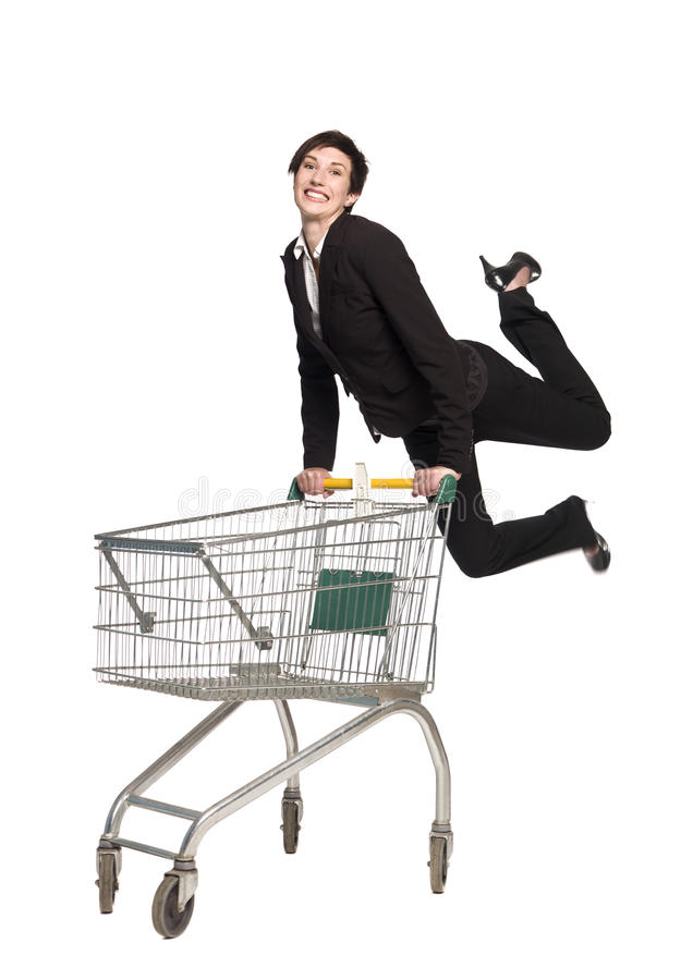 Woman with a shopping cart royalty free stock photography