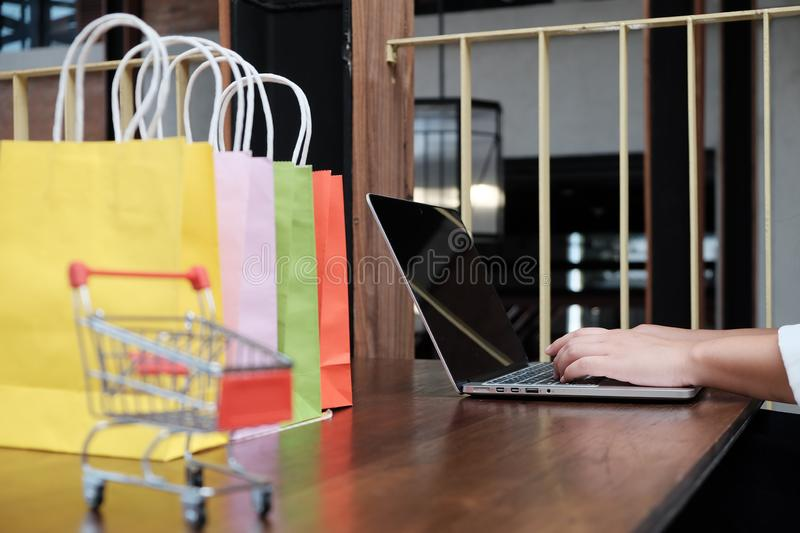 Woman shopping cart with Laptop for Internet online shopping concept. stock photos