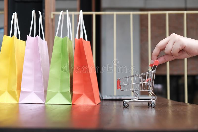 Woman shopping cart with Laptop for Internet online shopping concept. N stock photography