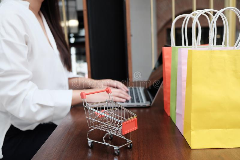 Woman shopping cart with Laptop for Internet online shopping concept. royalty free stock images
