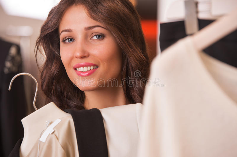 Woman shopping choosing dresses royalty free stock photography