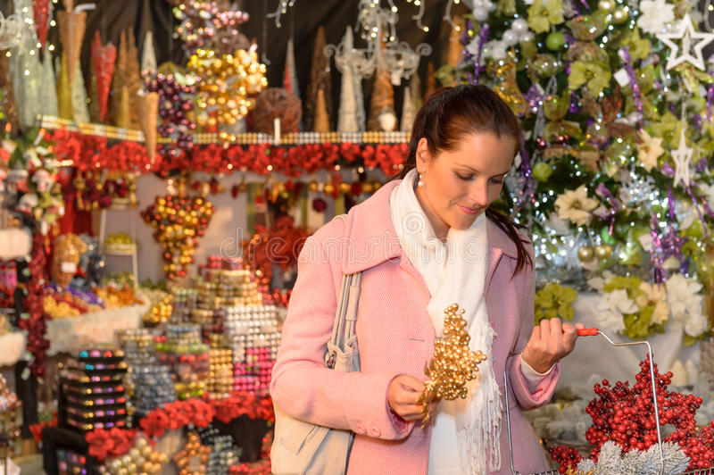 Woman shopping Christmas decorations festive mood stock image