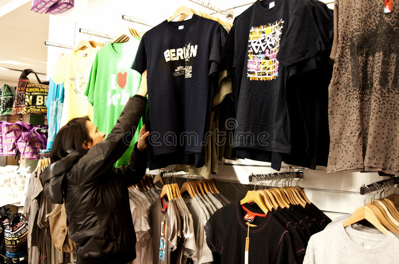 Woman shopping for clothes stock photography