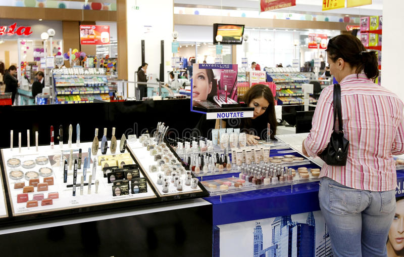 Woman shopping for cosmetics at supermarket stock photos