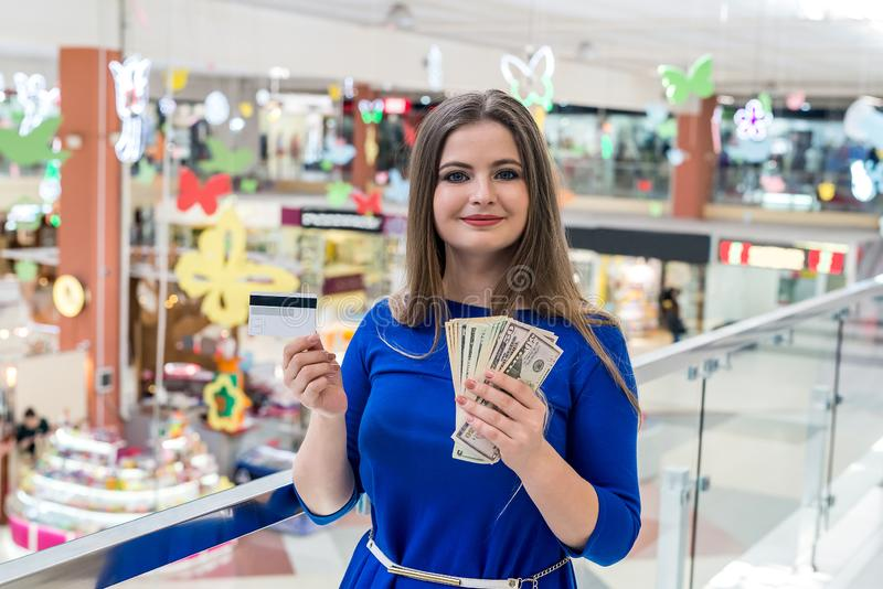 Woman on shopping with dollars and credit card . stock image