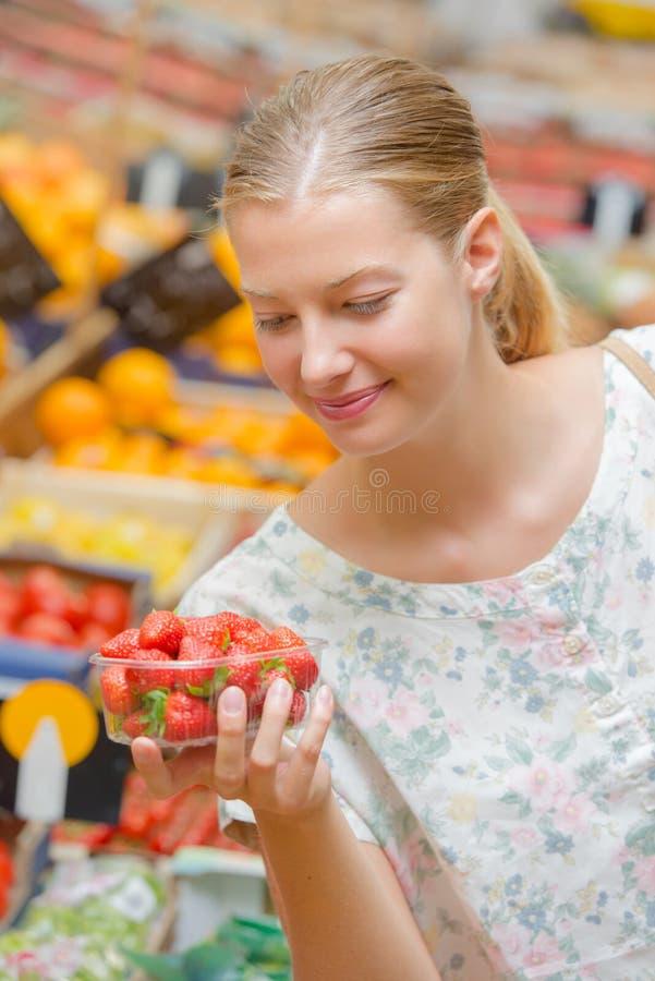 Woman shopping fruit. A woman is shopping fruit stock photos