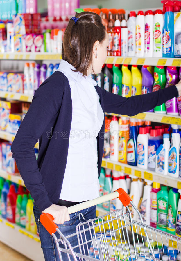 Woman shopping in grocery store. Young woman shopping in a grocery store royalty free stock images