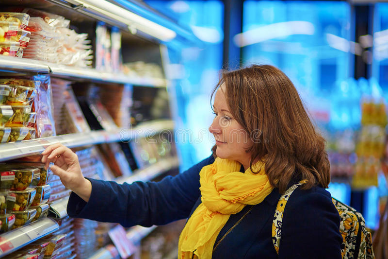 Woman shopping in a grocery store/supermarket stock images