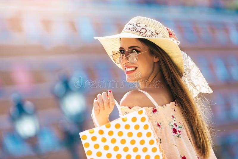 Woman in shopping. Happy woman with shopping bags enjoying in shopping stock image