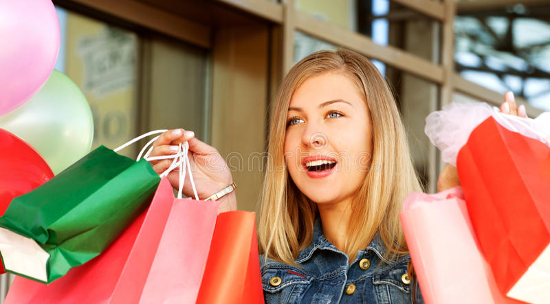 Woman shopping and holding bags royalty free stock photo